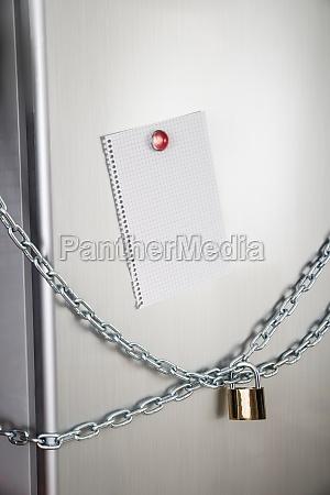 blank note of locked fridge
