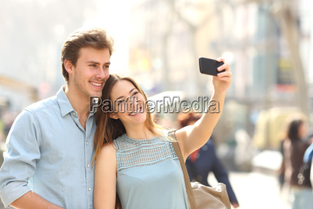 couple of tourists photographing a selfie