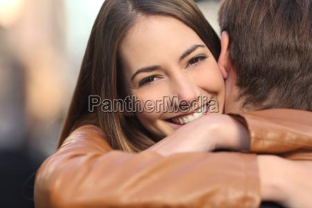 happy girlfriend hugging her boyfriend and