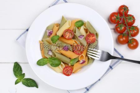 colorful penne rigate noodles pasta dish