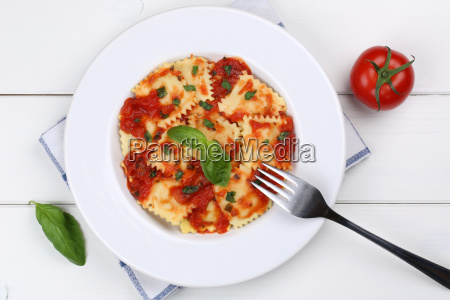italian pasta ravioli with tomato sauce