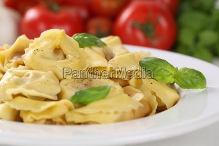 italian pasta tortellini with tomato and