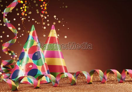 party hats and streamers on table
