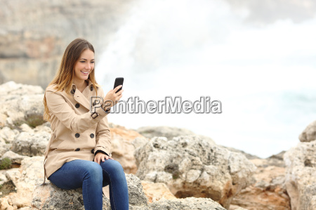 woman using a smart phone on