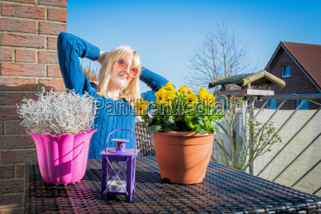 woman enjoys the sun in spring