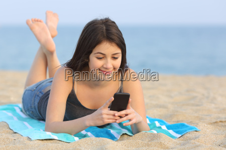 teenager girl texting a smart phone