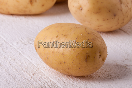 fresh washed unpeeled potatoes as closeup