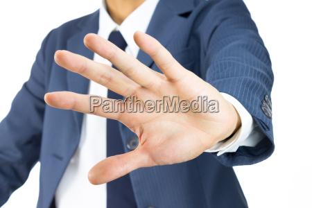 geschaeftsmann stop schild handgeste auf tilt