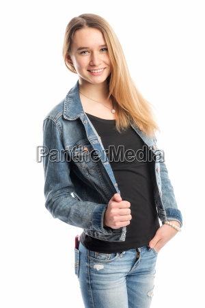 young blonde girl in jeans smiling