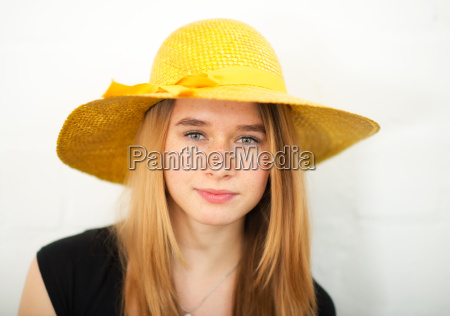 blond teenager wearing a straw hat