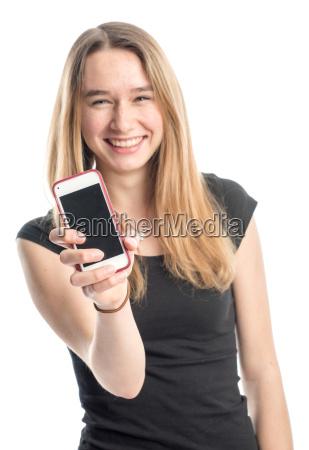 jugendliche, präsentiert, ein, handy, und, lächelt - 13867739