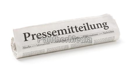 zeitungsrolle mit der UEberschrift pressemitteilung