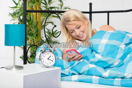 woman lying in bed at night