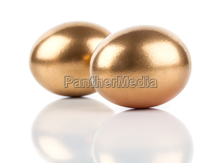 golden eggs isolated on white background