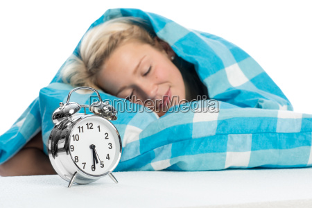 blonde woman lying relaxed in bed