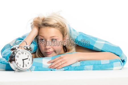 blond woman lying sleepless in bed
