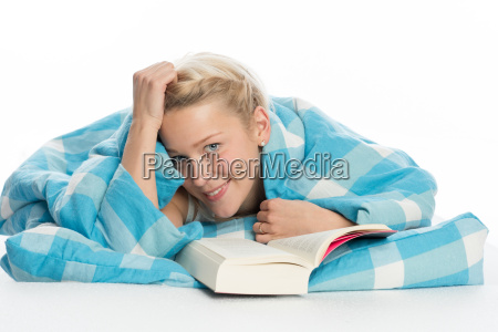 blonde woman lying in bed and