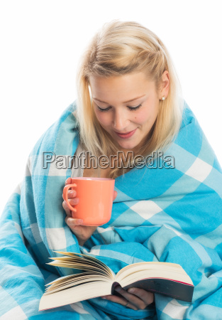 woman sitting with coffee and book