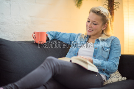 young woman sitting on a sofa