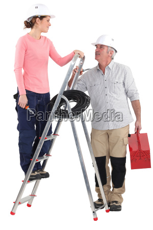 electrician working with new female recruit