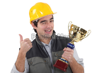 craftsman winking holding trophy