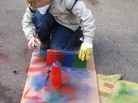 child sprayed timber to