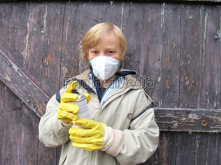 child in spraying paint