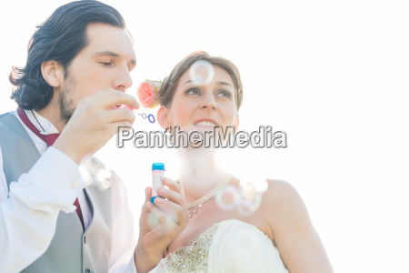 wedding parade blowing soap bubbles on