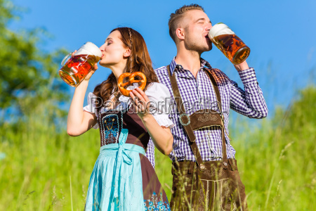 german couple in dress with beer