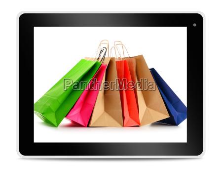 papier einkaufstaschen auf dem tablet bildschirm