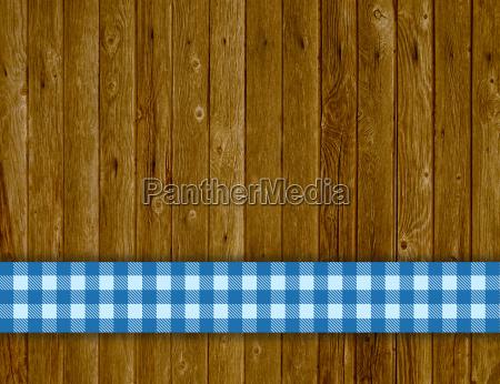 holzhintergrund mit tischdeckenstreifen blau