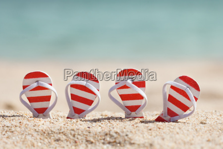 striped flip flops on beach
