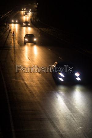 busy highway at night with cars