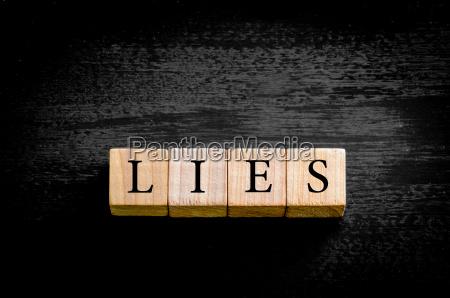 word lies isoliert auf schwarzem hintergrund