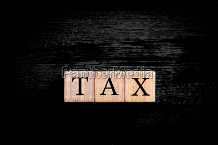 word tax isolated on black background