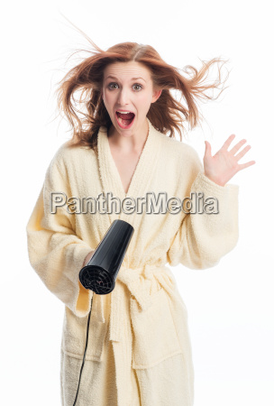 young woman in bathrobe foehnt her
