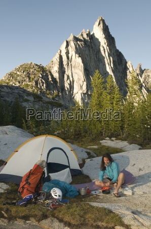 a woman camping below prussik peak