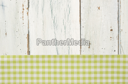 green checkered tablecloth in front of