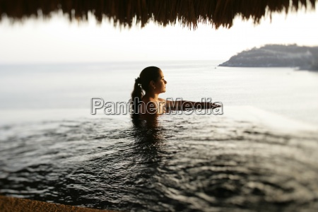 a woman in private pool