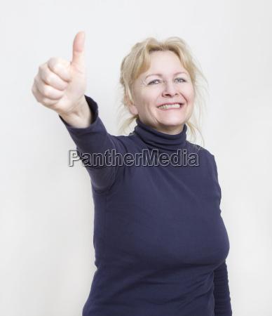 woman showing thumb
