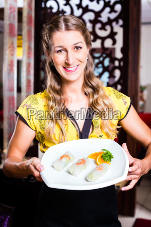 waitress in an asian restaurant with