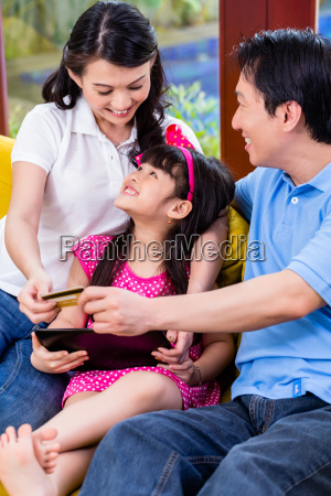 chinese family online shopping with tablet