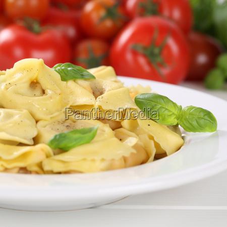 italian food pasta tortellini with tomato