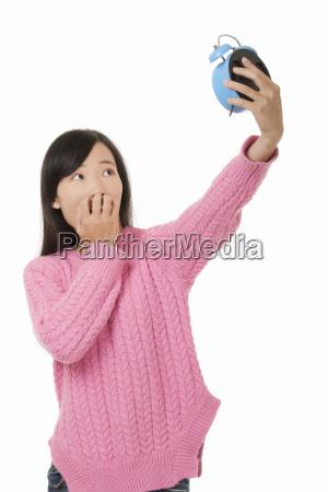 beautiful chinese woman holding a blue