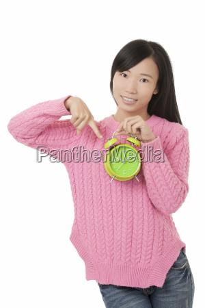 beautiful chinese woman holding a green