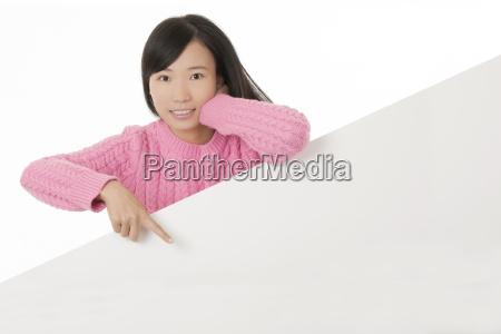 beautiful chinese woman holding a blank