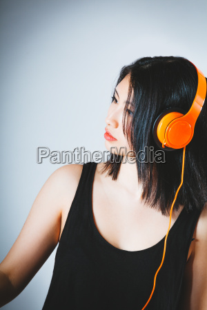 young asian woman concentrating on her