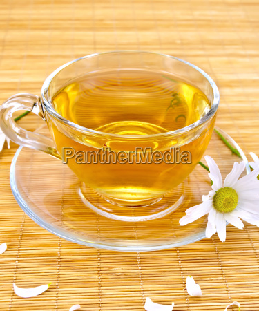 herbal tea with camomiles on bamboo