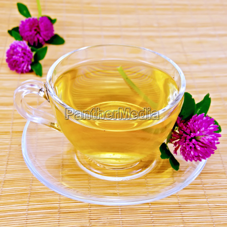 herbal tea with clover on bamboo
