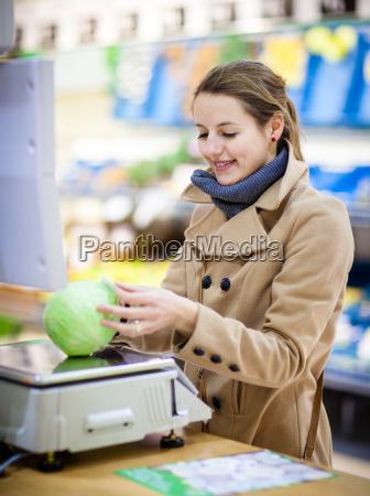 beautiful young woman shopping for fruits